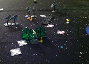 Ba'Racuda's lasers distort Tokitsukaze's shields.